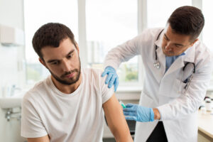 Man received a flu shot from a medical professional